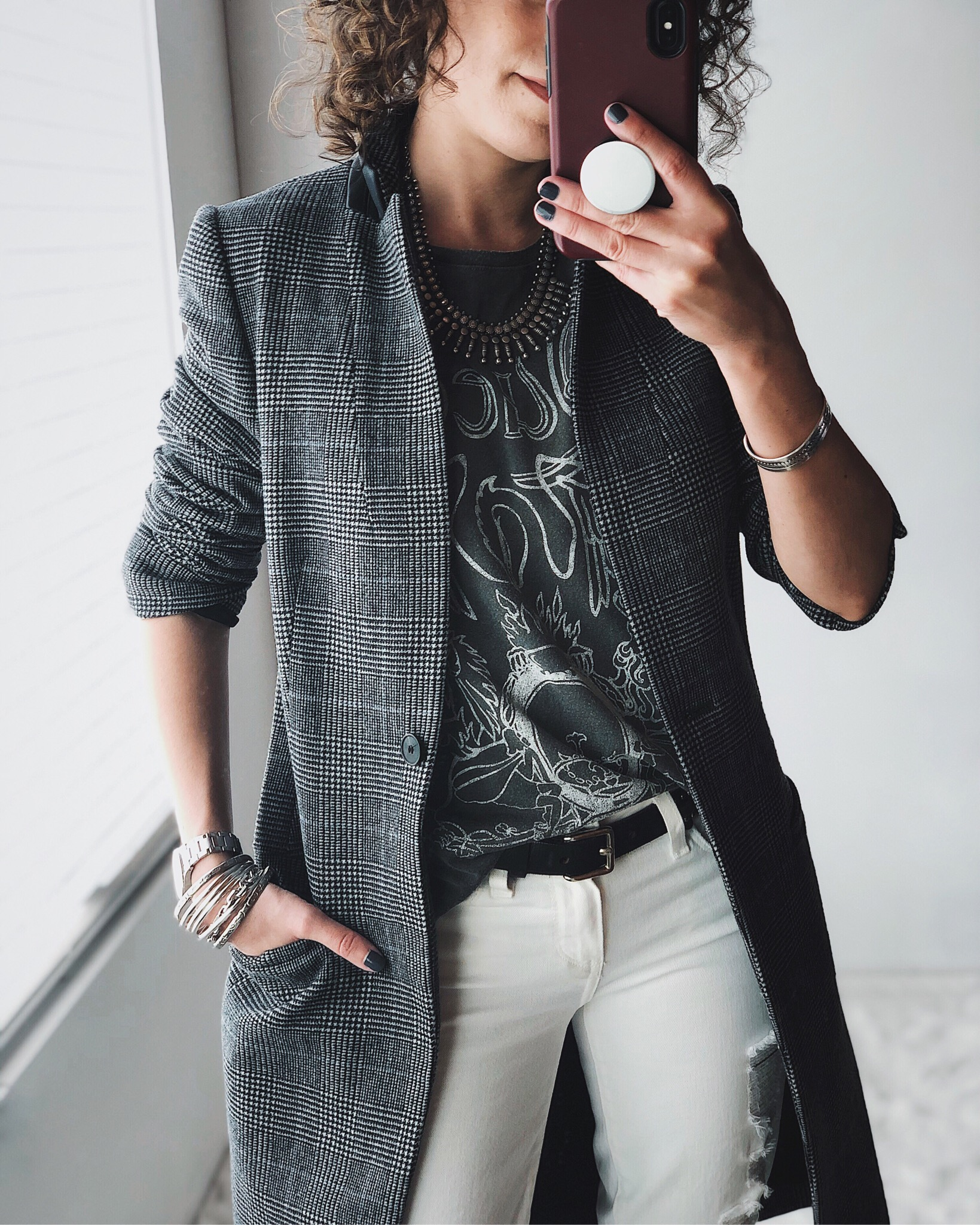 plaid coat, band tee, white jeans